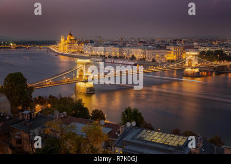 Looking down to the Danube river with parliament building and chain bridge in Budapest, Hungary - Stock Photo