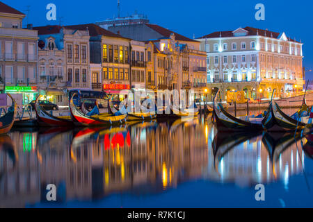 Moliceiros, boats anchored along the Central Channel at night, Aveiro, Centro region, Portugal - Stock Photo