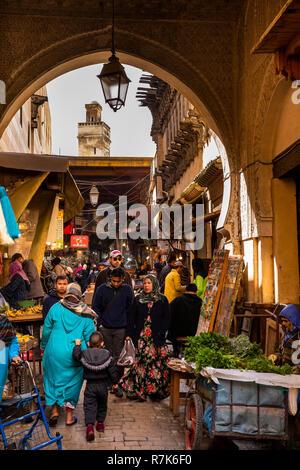 Morocco, Fes, Fes el Bali, Medina, Kasbah an-Nouar, local people shopping in vegetable souk - Stock Photo