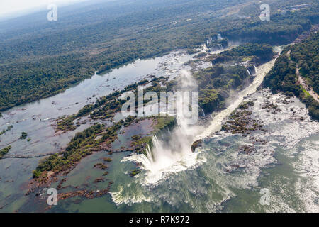 Aerial bird's-eye view panorama of Iguazu Falls from above, from a helicopter. Border of Brazil and Argentina. Iguassu, Iguacu waterfalls. - Stock Photo