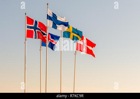 Danish, Swedish, Icelandic, Finnish and Norwegian scandinavian flags waving on the wind in Helsingborg, Sweden - Stock Photo