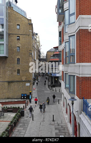 LONDON, UNITED KINGDOM - JANUARY 25: Shad Thames Street in London on JANUARY 25, 2013.  View from Tower Bridge at narrow streets in Southwark in Londo - Stock Photo