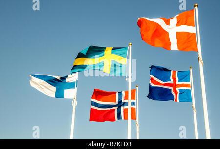 Danish, Swedish, Icelandic, Finnish and Norwegian scandinavian flags waving on the wind in Helsinborg, Sweden - Stock Photo
