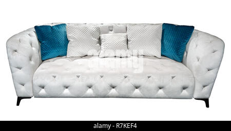 White modern chesterfield style velours sofa with pillow quilted upholstery close up. Capitone pattern texture background. Soft contemporary couch with cushions isolated background - Stock Photo