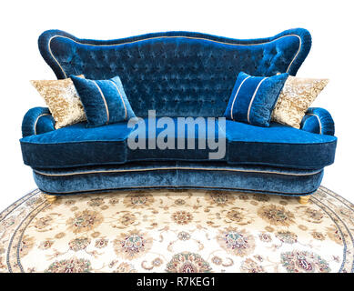 Blue velours sofa with pillows. Soft luxury classical couch with cushions isolated background - Stock Photo