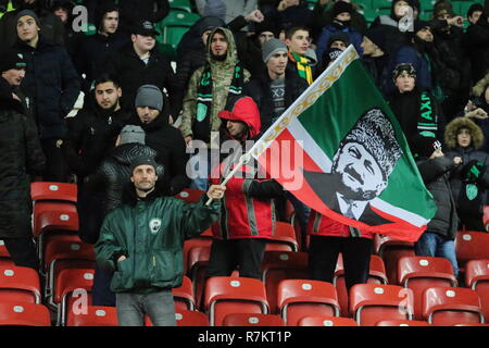 Grozny, Russia. 10th Dec, 2018. GROZNY, RUSSIA - DECEMBER 10, 2018: A supporter of FC Akhmat Grozny holds a Chechen flag featuring a likeness of Akhmad Kadyrov during a 2018/2019 Russian Football Premier League Round 17 football match between Akhmat Grozny and Arsenal Tula at Akhmat Arena in Grozny, Chechen Republic, Russia. Yelena Afonina/TASS Credit: ITAR-TASS News Agency/Alamy Live News - Stock Photo
