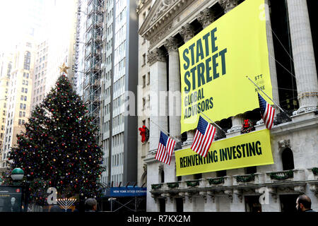 New York City, New York, USA. 10th Dec, 2018. The famed 4-foot tall bronze statue of the defiant young girl staring down Wall Street's 'Charging Bull'' has found a new home in front of the New York Stock Exchange on December 10, 2018. Originally installed to encourage corporations to put more women on their boards, the diminutive statue became a much loved symbol of female empowerment. The work of art was first installed on Broadway in March 2017. Credit: G. Ronald Lopez/ZUMA Wire/Alamy Live News Stock Photo