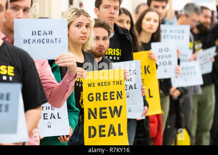 Washington, DC, USA. 10th Dec, 2018. Protesters seen holding placards during the Sunrise Movement protest inside the office of US Representative Nancy Pelosi (D-CA) to advocate that Democrats support the Green New Deal, at the US Capitol in Washington, DC. Credit: Michael Brochstein/SOPA Images/ZUMA Wire/Alamy Live News - Stock Photo
