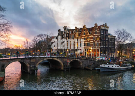Evening view of Brouwersgracht and Prinsengracht canals in Amsterdam, Netherlands - Stock Photo