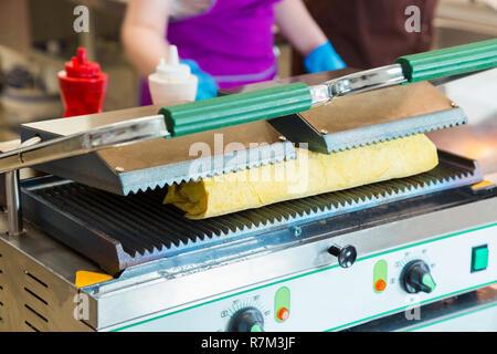 Preparation of shawarma on an electric furnace. - Stock Photo