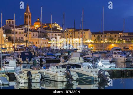 Italy, Sardinia, Western Sardinia, Alghero, view of the dome of the church San Michele and the bell tower of the cathedral Santa Maria - Stock Photo