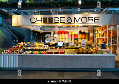 Cheese shop (Cheese & More) inside modern residential and commercial property development, Markthal , Market Hall, in Rotterdam, The Netherlands - Stock Photo