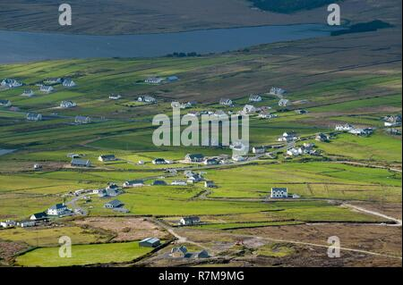 Republic of Ireland, County Mayo, Achill Island, small village and peat bogs - Stock Photo