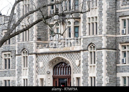 Washington DC, USA - April 1, 2018: Catholic University of America sign for Gibbons hall building in capital city, religious education - Stock Photo