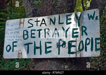 A hand-painted sign calls mayor Stan Wright a 'betrayer' for his decision to partner with BP after the BP oil spill in Bayou La Batre, Alabama. - Stock Photo
