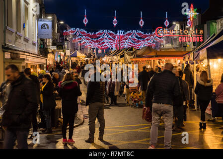 Crowds at the Victorian Christmas Market and lights at night, Bridge Street, Stratford upon Avon, England - Stock Photo