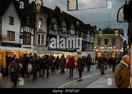 Victorian Christmas Market and lights in historic Union Street at night, Stratford upon Avon, England - Stock Photo