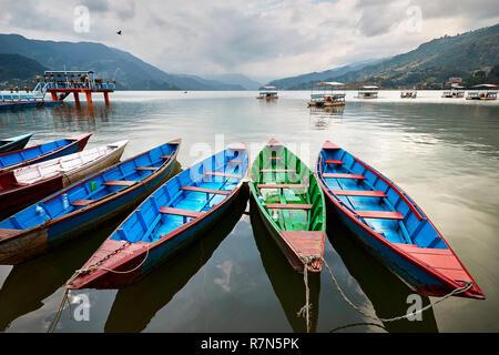Color boats at Phewa lake shore in Pokhara, Nepal. - Stock Photo