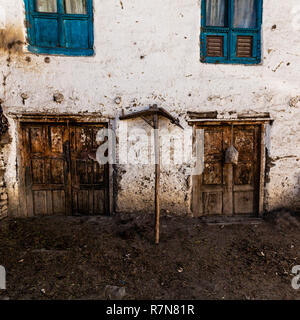 Old fashioned traditional dirty wood windows and doors in small mountain village in Nepal. - Stock Photo