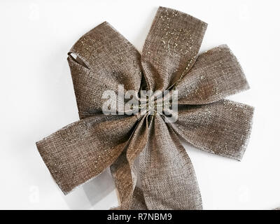 Shot of a beautiful star shape golden bow, the classic decoration to be placed on top of the Christams tree - Stock Photo