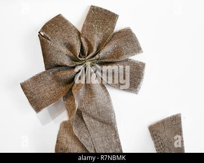 Shot of a beautiful star shape golden bow, the classic decoration to be placed on top of the Christmas tree - Stock Photo