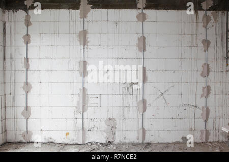 Preparing walls for plastering house  walls with metal holders interior. - Stock Photo