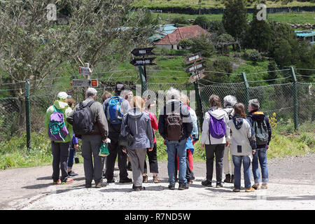 Hiking group at the signpost to Portela on Madeira - Stock Photo