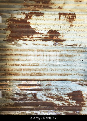 old detailed aged vintage rusty corrugated red brown silver textured zinc metal sheet exterior fence used in construction industry as house building m - Stock Photo