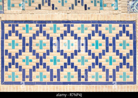 close up pattern of eastern, arabic ceramic, porcelain mosaic. Tiled background, oriental ornaments from Uzbekistan. - Stock Photo