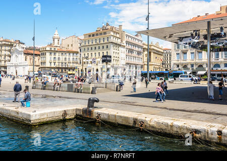 The quai des Belges on the Old Port in Marseille, France, with the metro station and L'Ombriere, the mirrored sunshade by Norman Foster. - Stock Photo