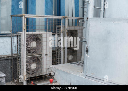Air compressor machine part of air conditioner system on roof deck - Stock Photo
