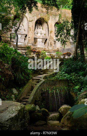 Candi Gunung Kawi hindu temple with niched carved stupas and water stream in Bali, Indonesia. - Stock Photo