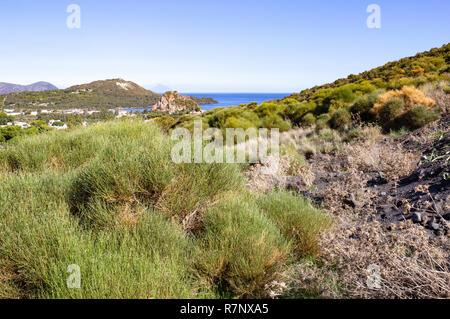 Volcano island. Aeolian archipelago close to Sicily.  Mediterranean sea on a sunny day. In the background other islands - Stromboli, Lipari. - Stock Photo