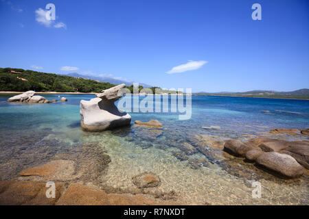 The bay of Figari near the city of Calderello. Island of Corsica, France. Wonderful secluded beach with rocks in the foreground. Copy space at the bot - Stock Photo