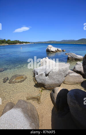 The bay of Figari near the city of Calderello. Island of Corsica, France. Wonderful secluded beach with rocks in the foreground. - Stock Photo