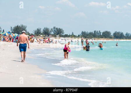 Sanibel Island, USA - April 29, 2018: Bowman's beach in Florida with children playing, sand, many people, crowd crowded coast, coastline, chairs durin - Stock Photo