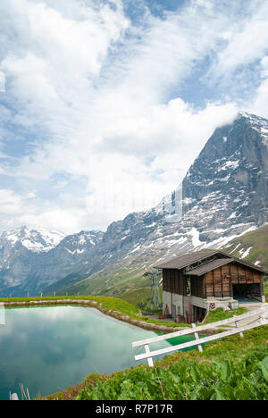 Switzerland, Kleine Scheidegg During the trek, I photographed a beautiful scenery with a pond. - Stock Photo