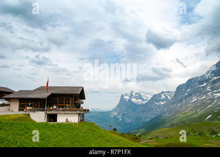 On the way to Jungfrau from Interlaken, Switzerland. When I transferred from Kleine Scheidegg to the mountain railway, I took a piture of a nice cafe. - Stock Photo