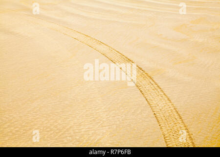 Beach Sand Pattern with Tire Mark Background. - Stock Photo