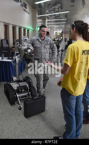 Senior Airman Ryan Garvey, 22nd Civil Engineer Squadron Explosive Ordinance Disposal journeyman, talks to For Inspiration and Recognition of Science and Technology Robotics competitors about one of EOD's robots March 24, 2017, in Oklahoma City, Okla. The EOD Airmen showcased their unique part of McConnell's mission set to teens interested in science, technology, electronics and mathematics careers. - Stock Photo