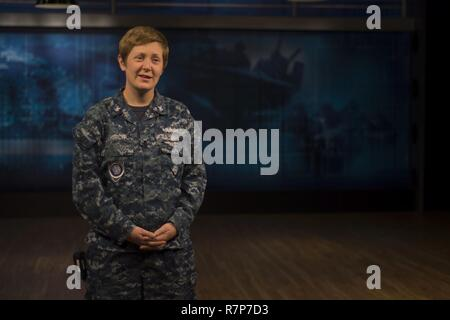 Mass Communication Specialist 2nd Class Kat Church, anchor and television broadcaster for All Hands Update, shares news at Defense Media Activity Headquarters. Church informs the Department of Defense  and the general public on the latest Navy news daily. - Stock Photo