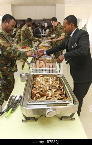 Caterers from the Ambassador Hotel provide meals for nearly 100 participants during the USARAF-led exercise Justified Accord 17, March 20-24, 2017, at the Peace Support Training Center in Addis Ababa, Ethiopia. JA17 is an annual weeklong joint exercise that brings together U.S. Army personnel, African partners, allies and international organizations to promote interoperability between participating nations for peacekeeping operations in the East Africa region. - Stock Photo