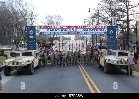 A collection of registrants wait to begin the All American Marathon Mar. 26, 2017 in Fayetteville, N.C. The marathon started at Fayetteville's Festival Park and allowed the event goers an opportunity to run through the center of the historic portion of the city, passing the Airborne and Special Operations Museum. - Stock Photo