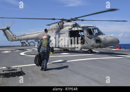 MEDITERRANEAN SEA (March 22, 2017) Cmdr. Andria Slough, commanding officer of the guided-missile destroyer USS Porter (DDG 78), prepares to board a Westland WG-13 Lynx helicopter, assigned to the French Navy frigate FS Montcalm (D 642), during exercise Dynamic Manta 2017, March 22. Dynamic Manta is an annual multilateral Allied Maritime Command (MARCOM) exercise meant to develop interoperability and proficiency in anti-submarine and anti-surface warfare. Porter, forward-deployed to Rota, Spain, is conducting naval operations in the U.S. 6th Fleet area of operations in supp - Stock Photo