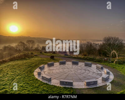 Wirksworth, Derbyshire Dales, Peak District, UK. 11th December, 2018. UK Weather: spectacular sunrise with cloud inversion at the star disc above Wirksworth in the Derbyshire Dales, Peak District National Park Credit: Doug Blane/Alamy Live News - Stock Photo