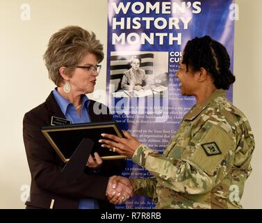 Virginia Young (left), mayor of the city of Sherwood, is presented a certificate of appreciation by Chief Warrant Officer Cassandra Green, Arkansas National Guard Equal Opportunity Manager, after concluding a speech during the National Guard's Professional Education Center's Women's History Month observance on March 29, at the Robinson Maneuver Training Center. - Stock Photo