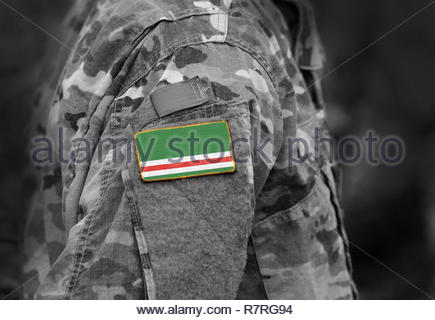 Flag of Chechen Republic of Ichkeria on military uniforms. Flag of Chechen Republic of Ichkeria on soldiers arm.  (collage). - Stock Photo