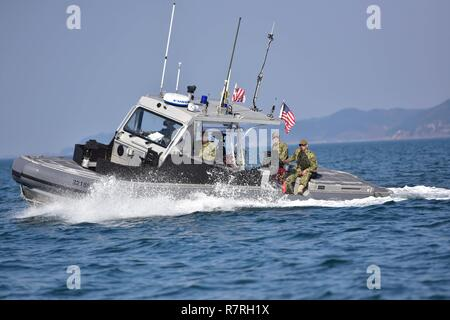 U.S. Coast Guardsmen assigned to Coast Guard Port Security Unit 312 conduct an underway area familiarization patrol aboard a 32-foot transportable port security boat during Operation Pacific Reach Exercise 2017 (OPRex17) in Pohang, South Korea, April 2, 2017. OPRex17 is a bilateral training event designed to ensure readiness and sustain the capabilities which strengthen ROK-U.S. Alliance. - Stock Photo