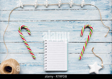 To do list on a blue and white wooden background. Top view, flat lay, copy space. Winter, Christmas and New Year celebration to do list concept. - Stock Photo