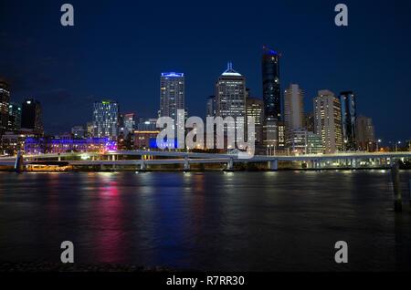 Brisbane city centre and Brisbane River at night, Queensland, Australia - Stock Photo